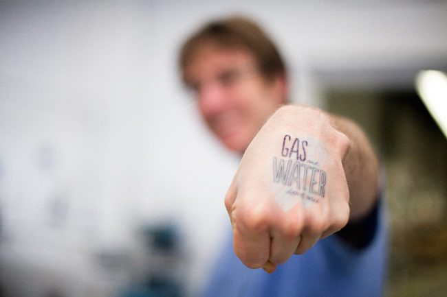 "Fracking tattoos come with every boxed set of Smock's new ""Fracking"" card"