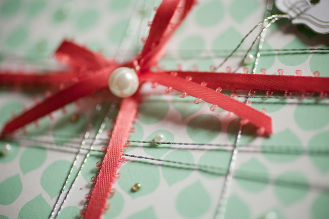 Double-sided gift wrap from Smock was used for this pretty present, complete with metallic thread, pink ribbon and tiny gems